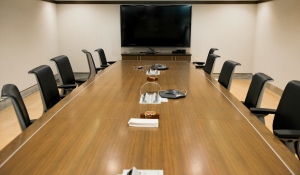a conference board room / with a long table and chairs / great for the meetings